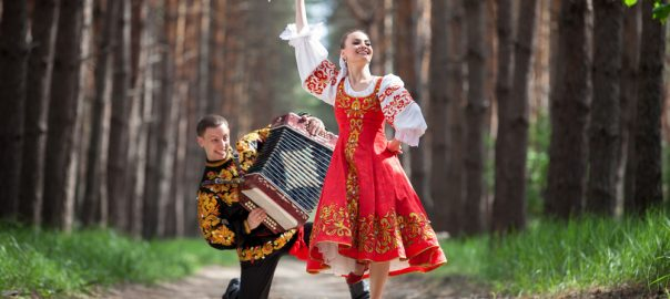 Man and woman in Russian national clothes